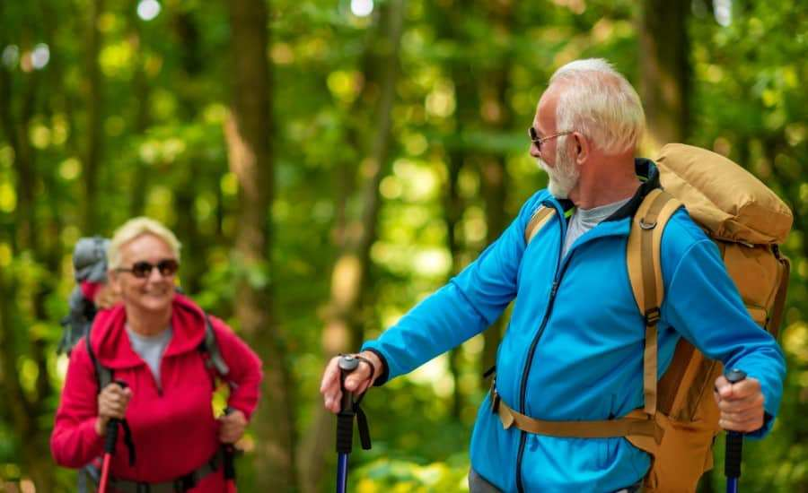 senior hikers hiking in nature