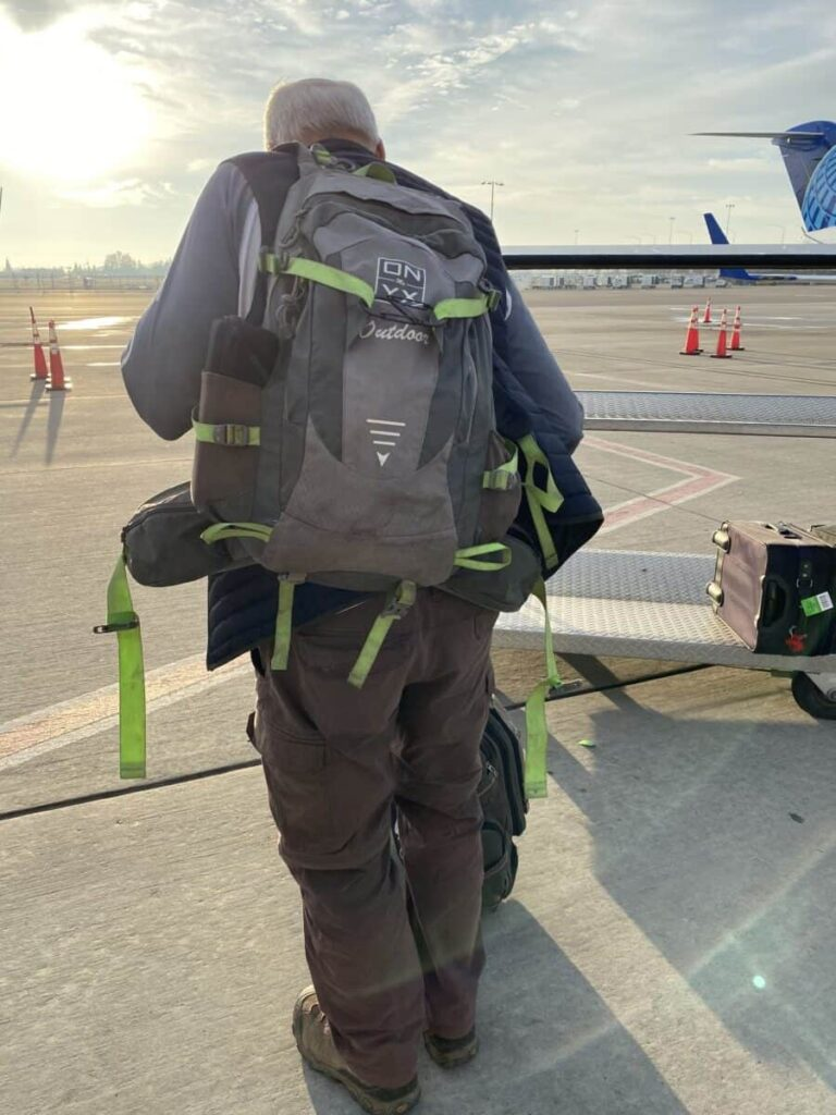 with boarding a plane with a hiking backpack for a carry on.
