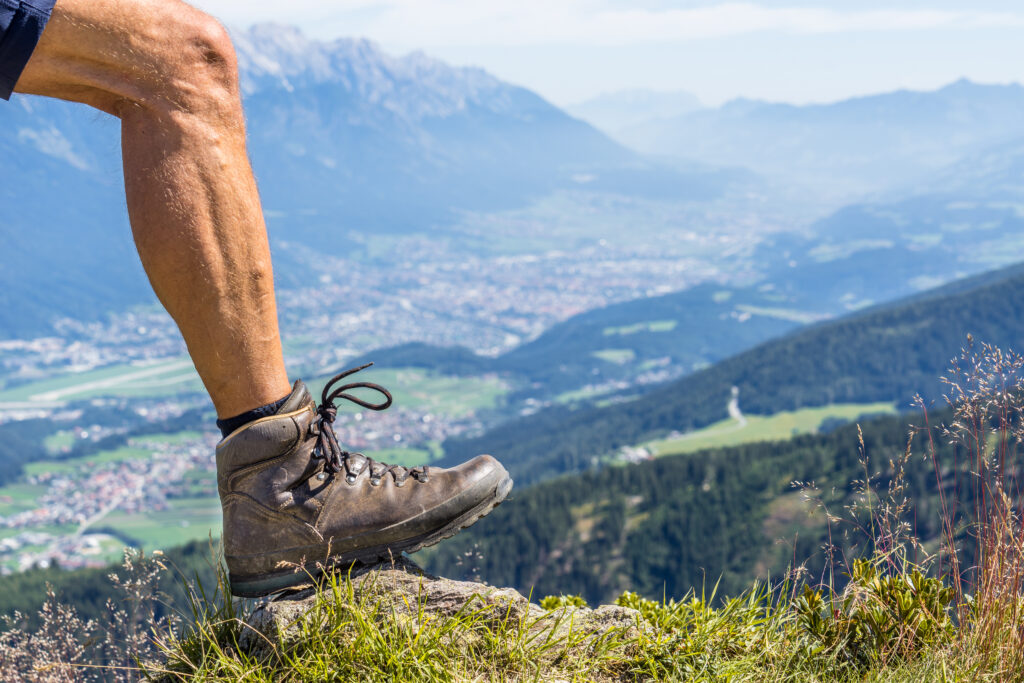 man with leg muscles in hiking boots