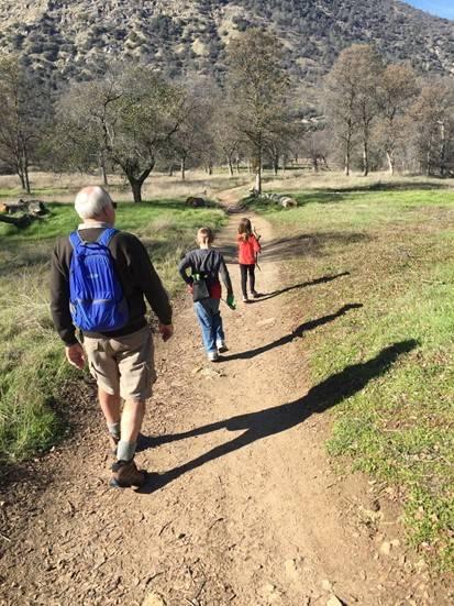 boy and girl hiking with grandpa