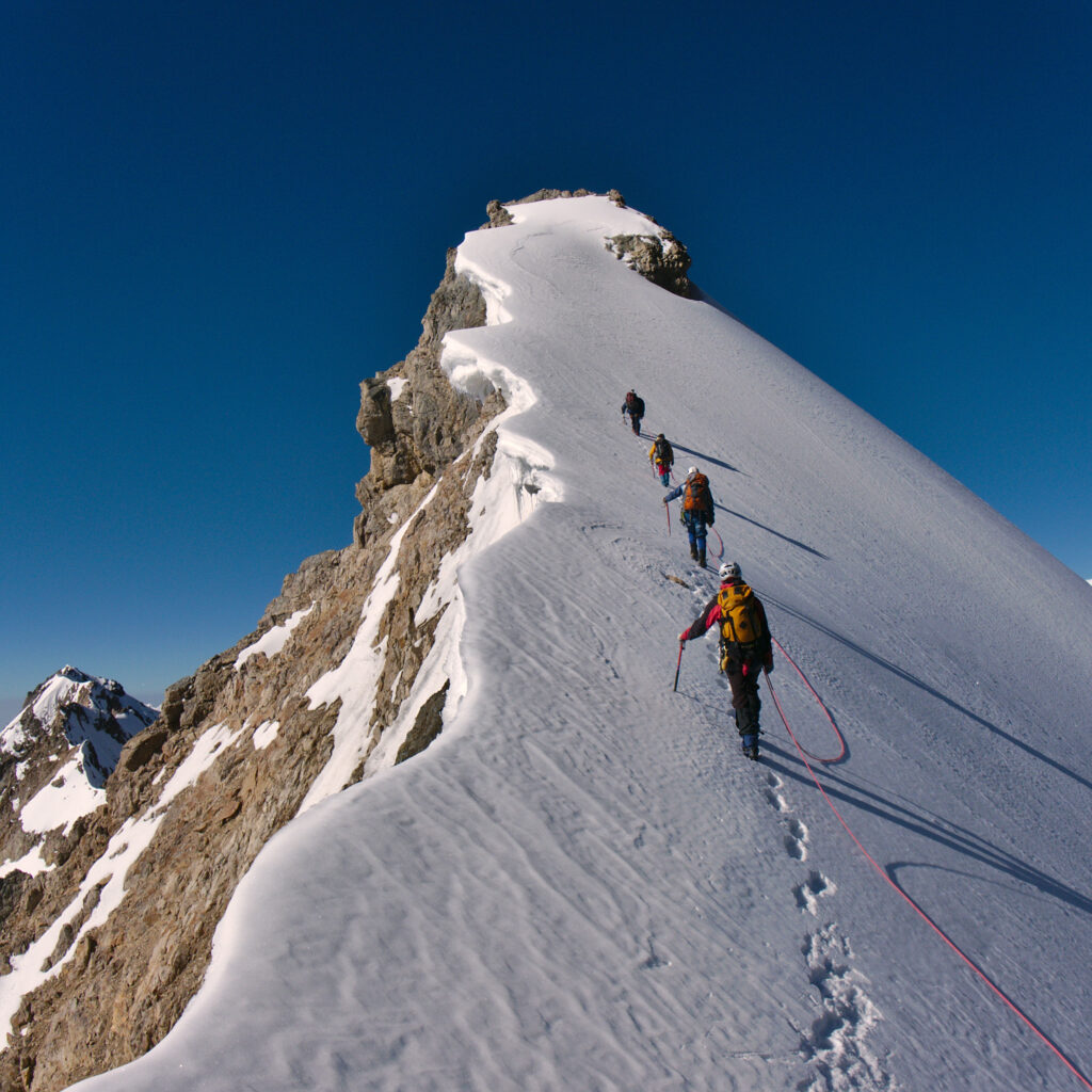 hikers hiking a steep mountain