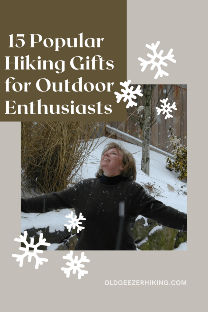 15 popular hiking gifts for outdoor enthusiasts. Woman looking up to the snow