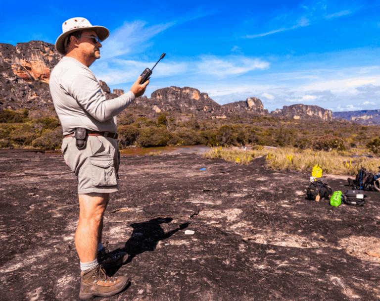 Senior hiker hold satellite communication device