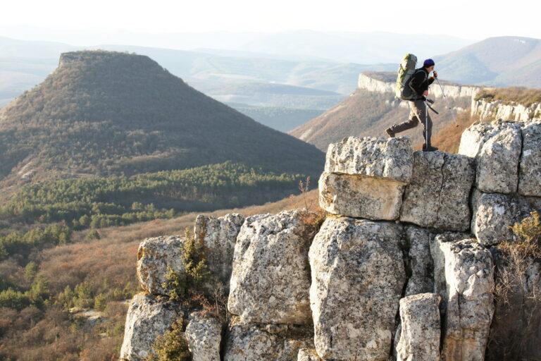 man hiking on top of rocks