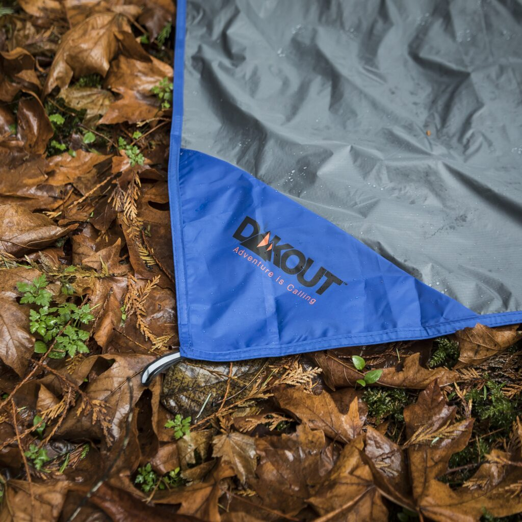 waterproof tarp on the ground in the woods.