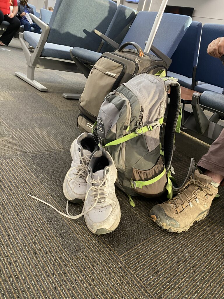backpack as a carry on in airport waiting area