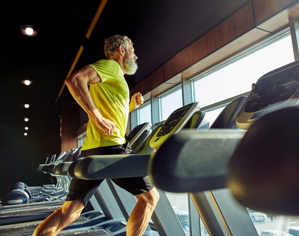 man exercising on a treadmill off the hiking trail.