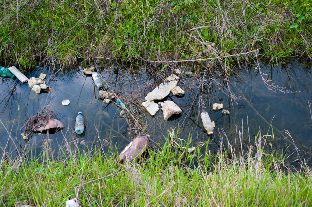 stream with waste and debris that show why you need to purify water when hiking