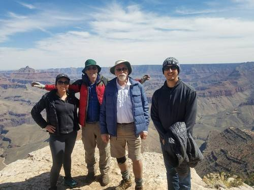 Four friends Hiking grand Canyon