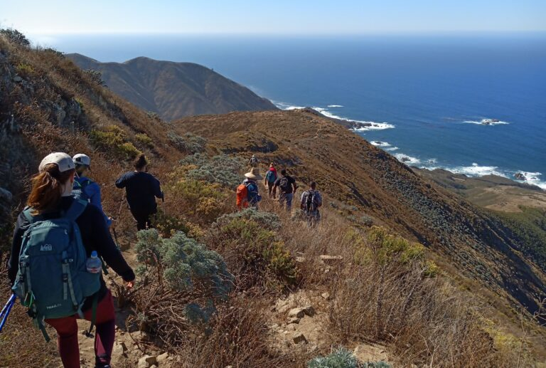group of hikers on the loop trail at Garrapata State Park in California's central coast.