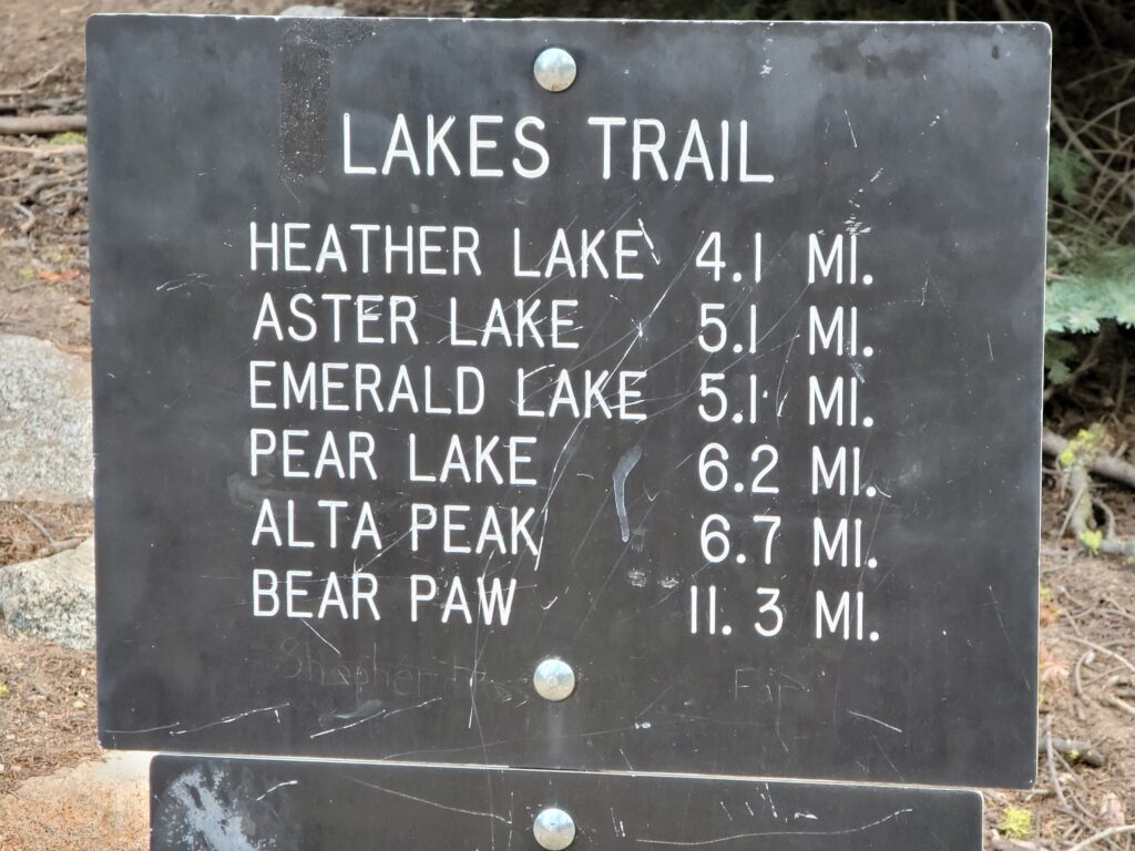 sign with Lakes Trail distance information.