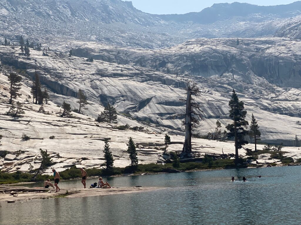 backpackers swimming in Pear Lake at Sequoia National Park.