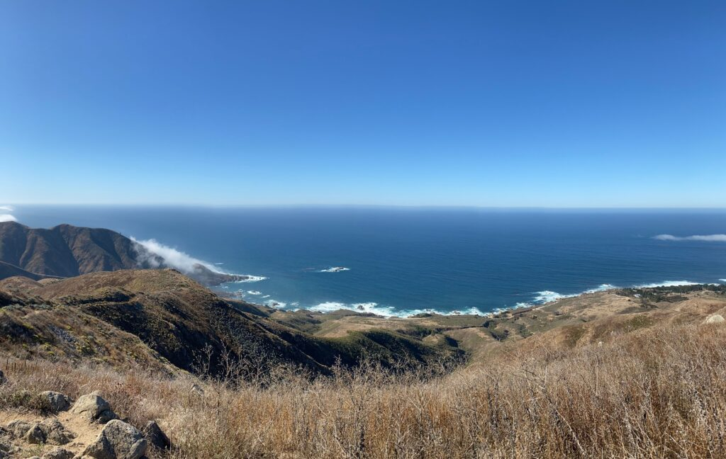 ocean with hiking loop trail in foreground.