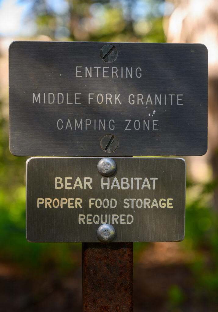 sign that says bear habitat proper food storage required