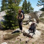 basic backpacking skills with woman in the mountains