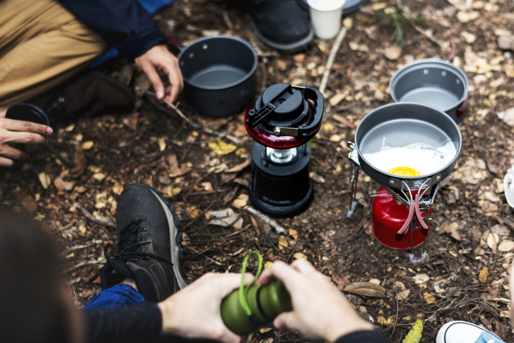 basic backpacking skill cooking over a fire.